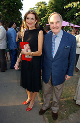 LORD & LADY PALUMBO at the Serpentine Gallery Summer party sponsored by Yves Saint Laurent held at the Serpentine Gallery, Kensington Gardens, London W2 on 11th July 2006.<br />