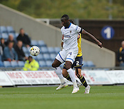 AFC Wimbledon forward Adebayo Azeez (14) holds the ball up during the Sky Bet League 2 match between Oxford United and AFC Wimbledon at the Kassam Stadium, Oxford, England on 10 October 2015.
