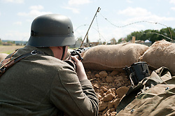 Reenactors portray panzer grenadiers during he Spam 1940s Wartime Weekend Heckmondwike day one.<br />