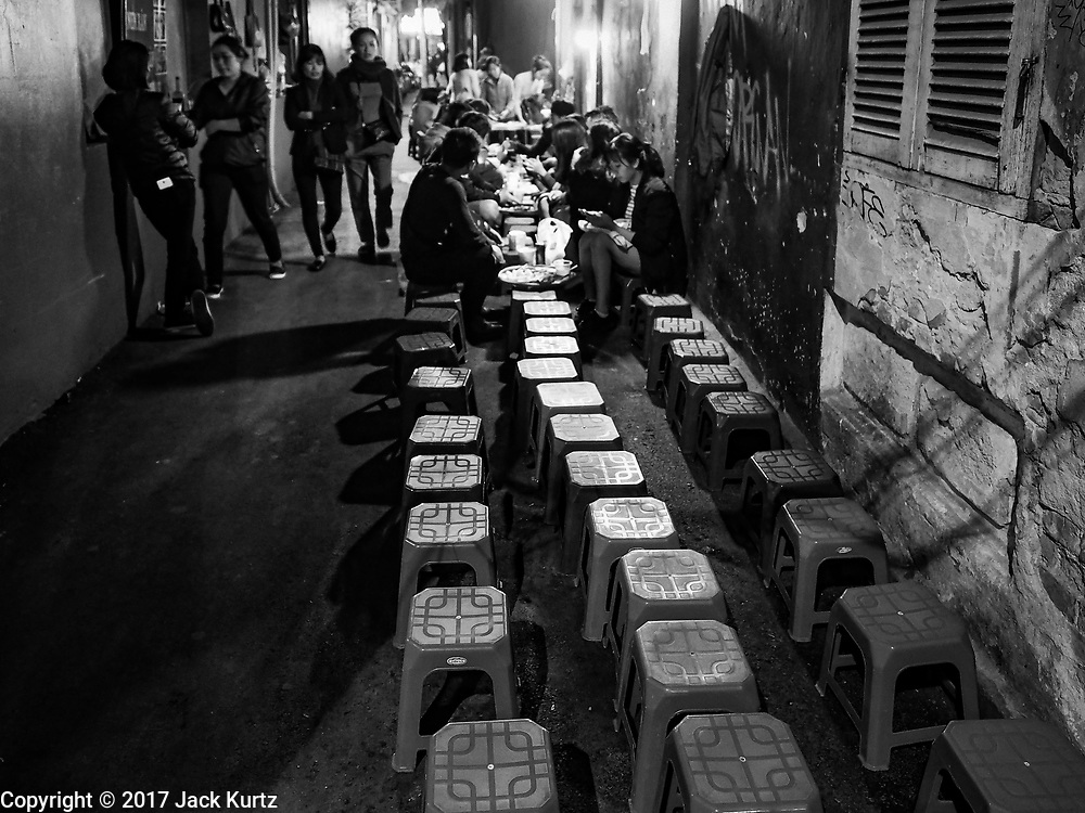 25 DECEMBER 2017 - HANOI, VIETNAM: A street food stand in the Old Quarter of Hanoi, near St. Joseph's Cathedral.       PHOTO BY JACK KURTZ