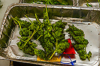 After pot is harvested, the flower is cut from the plant in the trim room. Medicine Man Denver is the single largest legal medical and recreational marijuana dispensary in Denver, Colorado USA. Their 20,000 sq. ft. facility will soon double in size. Radio frequency ID tags and 65 video cameras allow the State of Colorado to track inventory through the growing process and all plant weight is accounted for. Medicine Man won the High Times' Cannabis Cup for best sativa (Jack Herer). 20-30 strains are available for sale daily.