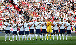 General view of England players during a minutes applauds for Ray Wilkins
