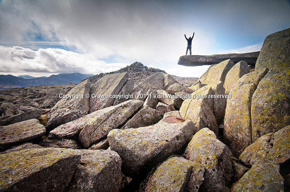 Walker on Cantilever Rock<br /> Walking<br /> Glyder Fach<br /> Glyderau<br /> Snowdonia<br /> North<br /> Activities and Sports