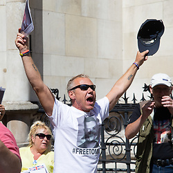 """Tommy Robinson's supporters cheer and chant """"Tommy's Coming Home"""" as an appeal by lawyers representing right wing activist Tommy Robinson win his release on bail ahead of a new hearing to be held at The Old Bailey, following his imprisonment on contempt of court charges. London, August 01 2018."""