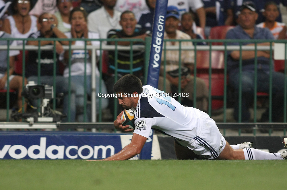 CAPE TOWN, SOUTH AFRICA - 28 February 2009: Paul Williams goes over to score during the Super 14 match between the Vodacom Stormers and the Blues held at Newlands Stadium in Cape Town. Photo by: Shaun Roy/ SPORTZPICS