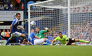 Ipswich Town defender Tommy Smith clears from Brighton striker, Tomer Hemed in the area during the Sky Bet Championship match between Ipswich Town and Brighton and Hove Albion at Portman Road, Ipswich, England on 29 August 2015.