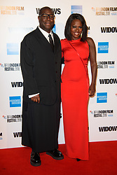 Steve McQueen (left) and Viola Davis arriving for the 62nd BFI London Film Festival Opening Night Gala screening of Widows held at Odeon Leicester Square, London.