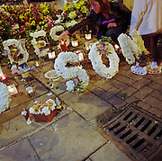 A memorial has been placed where a young man called ?Aiden? died in Prebend Street, London, England. If we just ignored this place where someone's life ended, the victim would just be a statistic but flowers are left to die too with touching poems written by family and loved-ones: ?Champion among men, now a champion of angels/A star in the Heavens has been named in memory of Aiden.? From a project about makeshift shrines: Britons have long installed memorials in the landscape: Statues and monuments to war heroes, Princesses and the socially privileged. But nowadays we lay wreaths to the ordinary who die suddenly - killed as pedestrians, as drivers or by alcohol, all celebrated on our roadsides and in cities with simple, haunting roadside remembrances.
