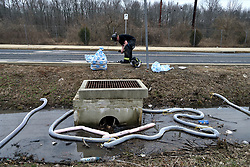 Absorbent booms are used to contain aqueous film forming foams (AFFF) from spilling into the surface water near a scene of a Class B fire of a tanker truck at an off ramp of the Interstate I-95, in Bensalem Township, Pennsylvania, on February 7, 2019. Aqueous film forming foams (AFFF) used in fighting fires of flammable liquids or flammable gases, oils, solvents and alcohols can contain sodium alkyl sulfate, fluorotelomers, perfluorooctanoic acid (PFOA) or perfluorooctanesulfonicacid (PFOS).<br /> The United States Environmental Protection Agency (EPA) is expected to release updates on tests of per- and polyfuoroalkyl substances or PFAs pollution in public water supplies for 16 million Americans in 33 states, including Pennsylvania. The federal report is delayed due to January 2019 shutdown. Reps. Brian Fitzpatrick, Republican of Bucks County in Eastern Pennsylvania and Democrat Dan Kildee, of Michigan cochair a bipartisan task force in the House of Representatives, formed to take on the growing PFAS Contamination Crisis. The usage of foam at nearby former military bases is linked to tainted drinking water, affecting tens of thousands of residents in Bucks and Montgomery Counties in Eastern Pennsylvania.