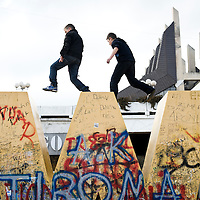 "Pristina, Kosovo 17 February 2011<br /> Youngsters play on the ""Newborn"" monument, during the celebrations of the 3rd anniversary of Kosovo's Independence.<br /> After the Kosovo War and the 1999 NATO bombing of Yugoslavia, the territory of Kosovo came under the interim administration of the United Nations Mission in Kosovo (UNMIK), and most of those roles were assumed by the European Union Rule of Law Mission in Kosovo (EULEX) in December 2008. <br /> In February 2008 individual members of the Assembly of Kosovo declared Kosovo's independence as the Republic of Kosovo. Its independence is recognised by 75 UN member states. <br /> On 8 October 2008, upon request of Serbia, the UN General Assembly adopted a resolution asking the International Court of Justice for an advisory opinion on the issue of Kosovo's declaration of independence.<br /> On 22 July 2010, the ICJ ruled that Kosovo's declaration of independence did not violate international law, which its president said contains no ""prohibitions on declarations of independence"".<br /> Photo: Ezequiel Scagnetti"
