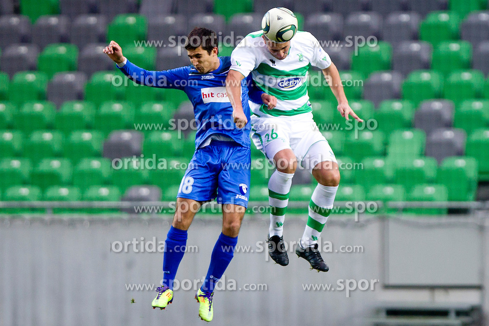 Vasja Simcic of NK Hit Gorica and Sreten Sretenovic of NK Olimpija during football match between NK Olimpija and NK HIT Gorica of 21th Round of First Slovenian League, on December 4th, 2011 at Src Stozice, Ljubljana, Slovenia. (Photo by Urban Urbanc / Sportida.com)