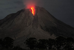 August 2, 2017 - Karo, North Sumatra, Indonesia - Hot liquid lava spilled from Mount Sinabung near Karo. The volcano destroys volcanic ash as high as 4.2 kilometers (2.2 miles), one of its biggest eruptions. In recent months high activity. (Credit Image: © Ivan Damanik via ZUMA Wire)