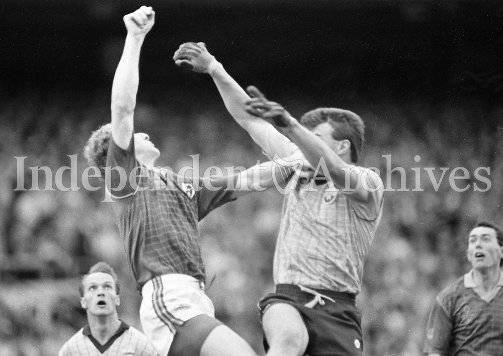 790-630<br /> Leinster Football Final at Croke Park, Dublin v Meath, 29th July 1990:<br /> Action on the pitch, two players jump.<br /> Meath 1-14 Dublin 0-14<br /> Pic: Dara Mac Donaill, 29/7/90<br /> (Part of the Independent Newspapers Ireland/NLI Collection)