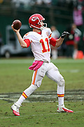 Kansas City Chiefs quarterback Alex Smith (11) throws a pass for a 30 yard completion to the Oakland Raiders 6 yard line in the third quarter during the 2016 NFL week 6 regular season football game against the Oakland Raiders on Sunday, Oct. 16, 2016 in Oakland, Calif. The Chiefs won the game 26-10. (©Paul Anthony Spinelli)