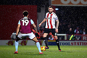 Brentford defender Harlee Dean (6) holding up the ball and screening it from Aston Villa midfielder Andre Green (19) during the EFL Sky Bet Championship match between Brentford and Aston Villa at Griffin Park, London, England on 31 January 2017. Photo by Matthew Redman.