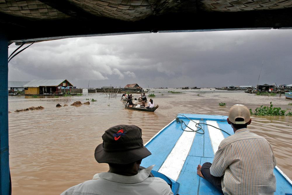 Boat taxi cruising Tonle Sap lake in Cambodia.