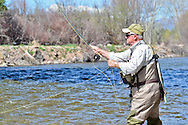Gil Hassinger casts for trout on the Roaring Fork River outside of Carbondale, Colorado.