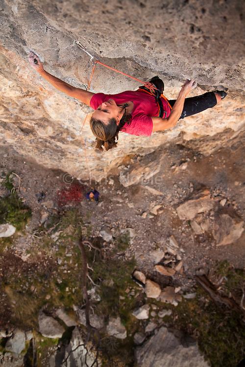 "Nancy Feagin climbing ""Resurrection,"" 13b, at ""The Wailing Wall,"" near St. George Utah."