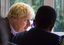 Michaela Community School, Wembley, London, June 23rd 2015. Mayor of London Boris Johnson visits the Michaela Community School, a Free School in Wembley that started taking students in September2014 after battling a certain amount of resistance from locals and unions. During the visit Head Teacher Katharine Birbalsingh took the Mayor on a tour of the school before he participated in a history lesson, prior to sitting down with pupils for brunch. PICTURED: Boris Johnson sits down to brunch with sudents from the school.