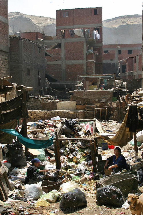 Zabaleen neighborhood in Cairo, Egypt. The Zabaleen districts (garbage collectors in Arabic) are home to the huge recycling industry run by the garbage collectors and their families. They recycle up to 87% of the trash they collect. The organic garbage is used to raise pigs and goats in their neighborhood.