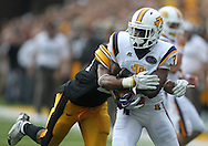 September 3, 2011: Tennessee Tech Golden Eagles wide receiver Tim Benford (3) is hit by Iowa Hawkeyes linebacker Christian Kirksey (20) after a catch during the second half of the game between the Tennessee Tech Golden Eagles and the Iowa Hawkeyes at Kinnick Stadium in Iowa City, Iowa on Saturday, September 3, 2011. Iowa defeated Tennessee Tech 34-7 in a game stopped at one point due to lightning and rain.