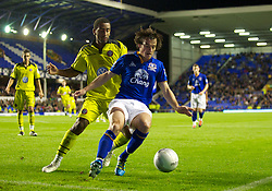 LIVERPOOL, ENGLAND - Wednesday, August 24, 2011: Everton's Leighton Baines in action against Sheffield United's Lee Williamson during the Football League Cup 2nd Round match at Goodison Park. (Pic by Dave Kendall/Propaganda)