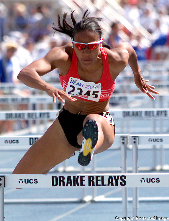 drake relays 2001 - Kim Carson, right, beat Sheila Burrell in the women's special 100 meter hurdles.  photo by david peterson