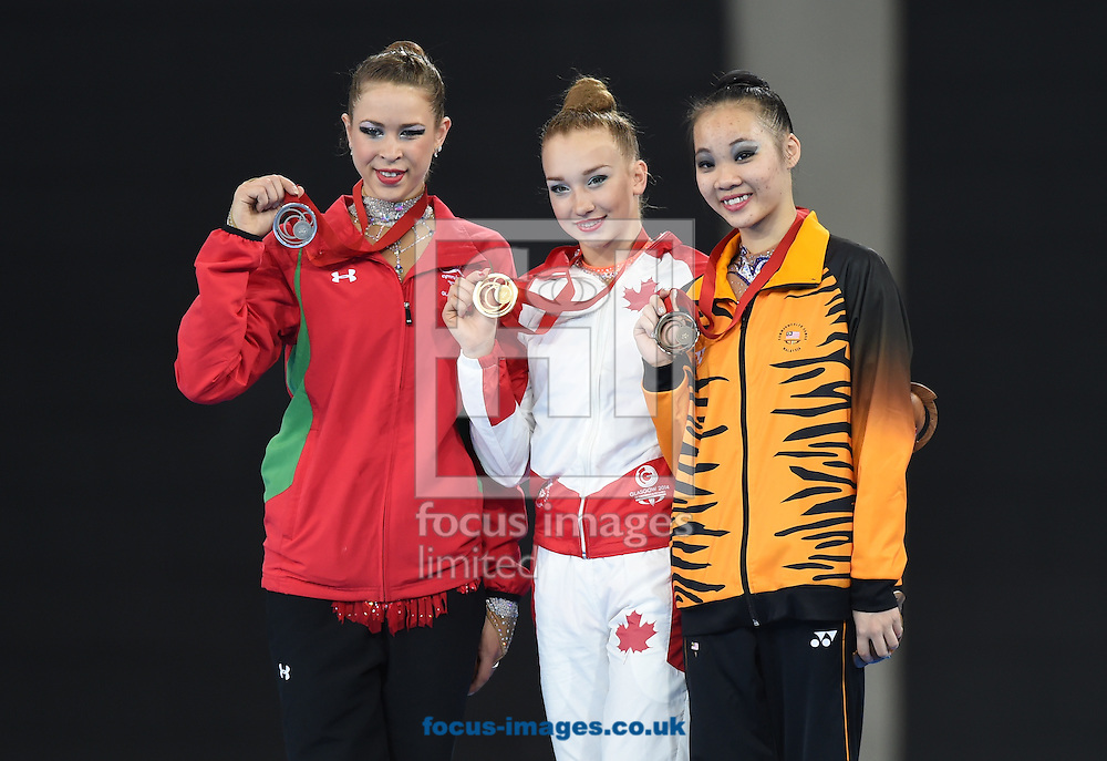 (LtoR) Francesca Jones WAL, Patricia Bezzoubenko CAN and Wong Poh San MAS medal winners  in the Rhythmic Gymnastics Hoops final at SSE Hydro, Glasgow<br /> Picture by Alan Stanford/Focus Images Ltd +44 7915 056117<br /> 26/07/2014