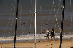 Walking on the beach in De Haan, Belgium, Sunday, Sept. 14, 2008. (Photo © Jock Fistick)