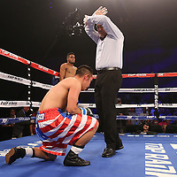 Nolasco Tomas fights Jonathan Irizarry during the Top Rank boxing event at Osceola Heritage Park in Kissimmee, Florida on September 22, 2016