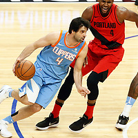18 March 2018: LA Clippers guard Milos Teodosic (4) drives past Portland Trail Blazers forward Maurice Harkless (4) on a screen set by LA Clippers center DeAndre Jordan (6) during the Portland Trail Blazers 122-109 victory over the LA Clippers, at the Staples Center, Los Angeles, California, USA.