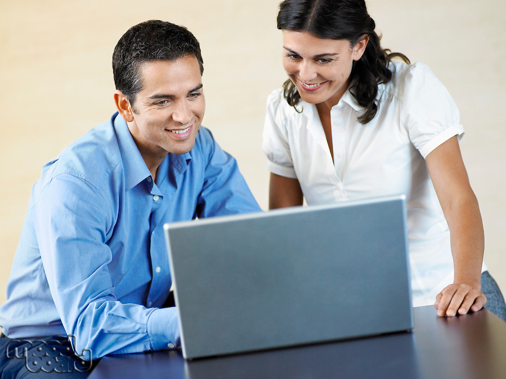 Office Workers Using Laptop Together