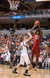 Maryland forward Bambale Osby (50) shoots a jump shot over Virginia forward Laurynas Mikalauskas (11).  The Virginia Cavaliers defeated the Maryland Terrapins 91-76 at the University of Virginia's John Paul Jones Arena  in Charlottesville, VA on March 9, 2008.