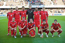 HELSINKI, FINLAND - Saturday, October 10, 2009: Wales' players line-up for a team group photograph before the 2010 FIFA World Cup Qualifying Group 4 match against Finland at the Olympic Stadium. Back row L-R: Aaron Ramsey, James Collins, Lewin Nyatanga, goalkeeper Wayne Hennessey, Ashley Williams, David Edwards. Front row L-R; David Vaughan, Simon Church, captain Craig Bellamy, Gareth Bale and Chris Gunter. (Pic by David Rawcliffe/Propaganda)