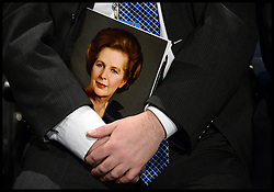 A attendee holds a booklet with the Late Lady Thatcher portrait on in Conference Hall on day one of the Conservative Party Conference in Manchester, United Kingdom. Sunday, 29th September 2013. Picture by  i-Images