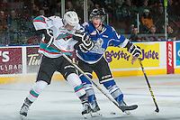 KELOWNA, CANADA - JANUARY 30: Devante Stephens #21 of Kelowna Rockets checks Jared Dmytriw #27 of Victoria Royals on January 30, 2016 at Prospera Place in Kelowna, British Columbia, Canada.  (Photo by Marissa Baecker/Shoot the Breeze)  *** Local Caption *** Jared Dmytriw; Devante Stephens;