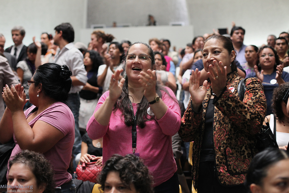 Human rights activists Claudia Samayoa (center) and Iduvina Hernandez clap after Judge Jazmin Barrios declares that Judge Flores' annulment is illegal and will be asking the Constitutional Court, Guatemala's highest judicial body, to rule on the fate of the genocide trial. Guatemala, Guatemala. April 19, 2013.