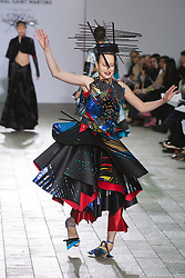 © Licensed to London News Pictures. 28/05/2013. London, England. Print collection by Min Nan Hui with model struggling on the catwalk. Central St Martins BA Fashion show with collections by graduate fashion students. Photo credit: Bettina Strenske/LNP