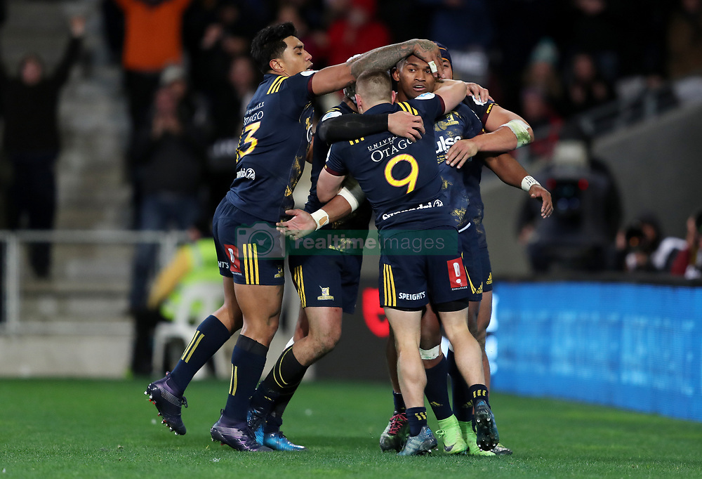 Highlanders' Waisake Naholo (right, obscured) is congratulated by team mates after scoring their first try during the tour match at Forsyth Barr Stadium, Dunedin.