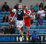 Millwall player Aiden O'Brien and Chesterfield player Liam O'Neill compete for a high ball during the Sky Bet League 1 match between Millwall and Chesterfield at The Den, London, England on 29 August 2015. Photo by Bennett Dean.