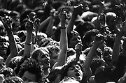 Concert crowd scene, hands in the air, UK, 1980's.