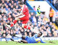 Essien of Chelsea tackles Downing of Middlesbrough