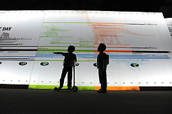 © licensed to London News Pictures. LONDON UK. 20/04/11. Twins Freece  and Zane Patel play next to a timeline graphic. Dinosaurs make a dramatic return to the London's Natural History Museum in this summer's family blockbuster exhibition, Age of the Dinosaur. .See special instructions for usage rates. Photo credit should read Stephen Simpson/LNP