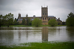 © London News Pictures. 01/05/2012. Tewkesbury, UK. Flood water in front of Abbey Church of St Mary the Virgin in Tewkesbury, Gloucestershire, England on May 1, 2012. The UK has had its wettest April in over a century, with some areas seeing three times their usual average rainfall, according to figures from the Met Office. Photo credit : Ben Cawthra /LNP