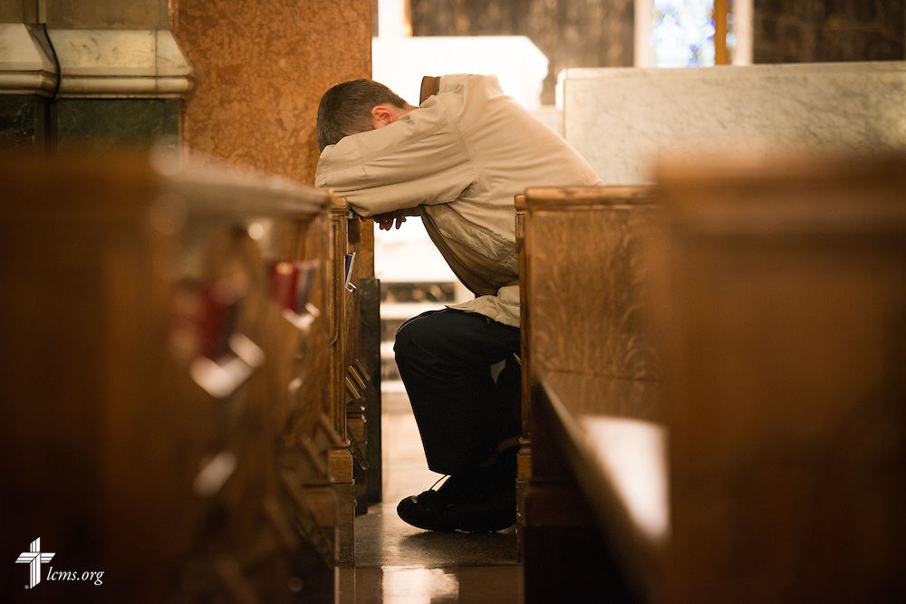 A new missionary for The Lutheran Church–Missouri Synod takes time out for prayer during a photographic practice session at the Cathedral Basilica on Thursday, March 5, 2015, in midtown St. Louis LCMS Communications/Erik M. Lunsford