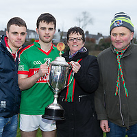 Kilmurry Ibrickane's captain Ciaran Morrissey with his parents and brother