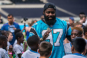 Mario Addison (DE, Carolina Panthers) greets the kids ahead of todays NFL Flag National Championship Finals  during the NFL UK Media Day at Tottenham Hotspur Stadium, London, United Kingdom on 3 July 2019.