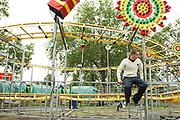 Teenager Sitting On Fairground Ride