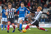 Macclesfield Town defender Michael Rose (24) battles with Grimsby Town midfielder Ben Pringle (30) (right) & Grimsby Town midfielder Jake Hessenthaler (7) (left) in for a tackle during the EFL Sky Bet League 2 match between Grimsby Town FC and Macclesfield Town at Blundell Park, Grimsby, United Kingdom on 12 January 2019.