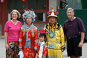Qiongdao (Jade Island) in Beihai Lake. Tourists posing with one-child-family posing in traditional Chinese clothes.